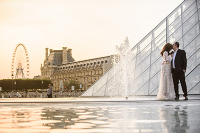 Couple renewing vows at Eiffel Tower in Paris