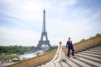 Couple in love eloping at Eiffel tower in Paris